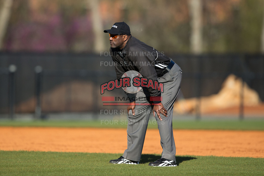 Third base umpire Linus Baker during the NCAA baseball game between the Louisiana Tech Bulldogs and the Charlotte 49ers at Hayes Stadium on March 28, 2015 in Charlotte, North Carolina.  The 49ers defeated the Bulldogs 9-5 in game two of a double header.  (Brian Westerholt/Four Seam Images)