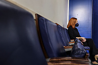 White House Press Secretary Jen Psaki listens as United States Secretary of Homeland Security Alejandro Mayorkas speaks during the daily press briefing in the Brady Press Briefing Room of the White House on Monday, March 1, 2021 in Washington, DC. <br /> Credit: Oliver Contreras / Pool via CNP /MediaPunch