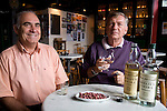 Renato Grasso Bollo and Wolfgang Schraeder, owners of Armazem Vieira, makers of fine cachassa, an alcohol distilled from sugar cane, Florianopolis, Santa Catarina, Brazil. Cashassa is the spirit of the region, often used in the signature cocktail, the caipirinha, or aged for slow sipping.