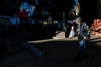 An elderly woman walks outside the Municipal Market of Hermosillo at the end of the day….<br /> December. Sunset winter 2019.<br /> Una anciana mujer  camina a las afueras del Mercado Municipal de Hermosillo al terminar el día….<br /> Diciembre. Atardecer invierno 2019.<br /> (Photo by Luis Gutierrez)