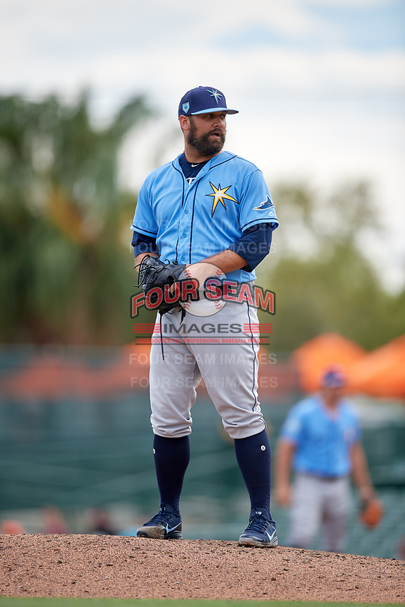 Tampa Bay Rays relief pitcher Andrew Kittredge (36) gets ready to deliver a pitch during a Grapefruit League Spring Training game against the Baltimore Orioles on March 1, 2019 at Ed Smith Stadium in Sarasota, Florida.  Rays defeated the Orioles 10-5.  (Mike Janes/Four Seam Images)