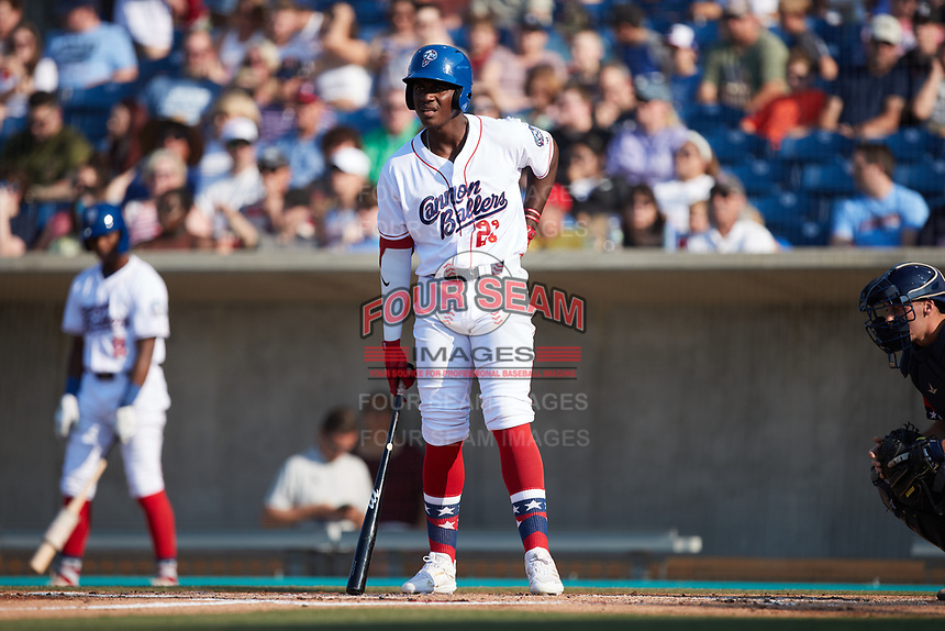 Luis Mieses (21) of the Kannapolis Cannon Ballers looks at his third base coach for the signs during the game against the Charleston RiverDogs at Atrium Health Ballpark on July 4, 2021 in Kannapolis, North Carolina. (Brian Westerholt/Four Seam Images)