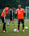 GUANGZHOU, GUANGDONG - JULY 26:  Franck Ribery and Mario Mandzukic of Bayern Munich during a training session ahead the friendly match against VfL Wolfsburg as part of the Audi Football Summit 2012 on July 26, 2012 at the Tianhe Sports Stadium in Guangzhou, China. Photo by Victor Fraile / The Power of Sport Images