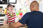 © Joel Goodman - 07973 332324 . 14/08/2015 . Hyde , UK . Staff serving a customer . McDonalds' order screen and waited table service at their branch in Mottram , Hyde . Photo credit : Joel Goodman
