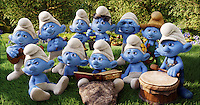 The Smurfs hear the story of how Smurfette came to be, as told in a medieval pop-up book.