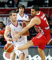 Novica VELICKOVIC (Serbia) fights for the ball with Omer ONAN (Turkey) during the semi-final World championship basketball match against Turkey in Istanbul, Serbia-Turkey, Turkey on Saturday, Sep. 11, 2010. (Novak Djurovic/Starsportphoto.com) .