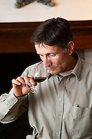 Alberic Mazoyer, then winemaker and director at Chapotier in Hermitage, now part-owner and wine maker at Alain Voge in Cornas. Tasting a glass of wine.  Domaine M Chapoutier, Tain l'Hermitage, Drome Drôme, France Europe