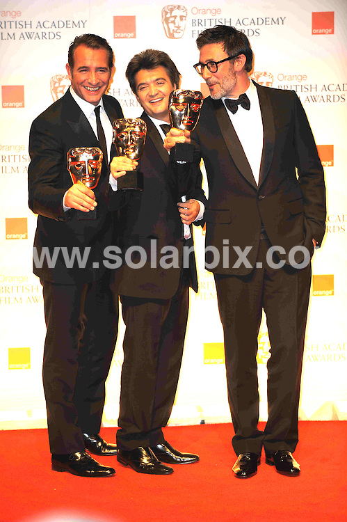 **ALL ROUND PICTURES FROM SOLARPIX.COM**                                             **WORLDWIDE SYNDICATION RIGHTS**                                                                                  Caption: Orange British Academy Film Awards at The .Royal Opera House in Covent Garden London                                                                              This pic:  Jean Dujardin, Thomas Langmann and Michel Hazanavicius                                                                        JOB REF:14467        MSR       DATE: 12.02.2012                                                           **MUST CREDIT SOLARPIX.COM OR DOUBLE FEE WILL BE CHARGED**                                                                      **MUST AGREE FEE BEFORE ONLINE USAGE**                               **CALL US ON: +34 952 811 768 or LOW RATE FROM UK 0844 617 7637**