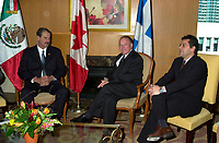Montreal, April 20, 2001<br /> The President of the United Mexican States ; His Excellency Vincente Fox Quesada (left) pose for photographers with Quebec Premier, the Honorable Bernard Landry,and Gilles Baril ; Quebec Minister of Industry and Comerce,  April 20, 2001 in Montreal, CANADA.<br /> President Fox will attend the Quebec Summit of the Americas opening today.<br /> Photo : Pierre Roussel