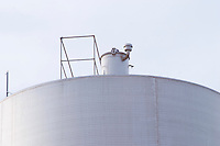 Top of a stainless steel fermentation tank. Hercegovina Produkt winery, Citluk, near Mostar. Federation Bosne i Hercegovine. Bosnia Herzegovina, Europe.