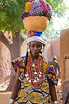 A Fulani woman from southwestern Niger attends the weekly market in Torodi, approximately 60 km sothwest of Nigeria's capital city of Niamey.  At the end of the market day, the village woman loads her goods on her head and begins the long walk home.