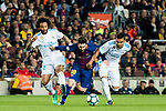 Lionel Andres Messi (C) of FC Barcelona competes for the ball with Marcelo Vieira Da Silva (L) and Carlos Henrique Casemiro of Real Madrid during the La Liga 2017-18 match between FC Barcelona and Real Madrid at Camp Nou on May 06 2018 in Barcelona, Spain. Photo by Vicens Gimenez / Power Sport Images