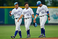 (L-R) Lane Adams #28, Steven Brooks #19 and Kenny Swab #61 of the Burlington Royals prior to the game against the Danville Braves at Burlington Athletic Park on August 12, 2011 in Burlington, North Carolina.  The Braves defeated the Royals 8-3.   (Brian Westerholt / Four Seam Images)