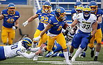 BROOKINGS, SD - MAY 8: Jordan Meachum #8 of the South Dakota State Jackrabbits slips the tackle of Ryan Coe #40 of the Delaware Fightin Blue Hens on May 8, 2021 in Brookings, South Dakota. (Photo by Dave Eggen/Inertia)