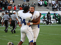 Armwood Hawks lineman Cameron Dees #66 and KJ Miles #34 celebrate after the Florida High School Athletic Association 6A Championship Game at Florida's Citrus Bowl on December 17, 2011 in Orlando, Florida.  Armwood defeated Miami Central 40-31.  (Mike Janes/Four Seam Images)
