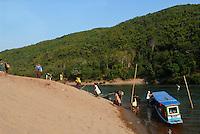 LAOS, river Nam Ou, a branch of Mekong, people travel with public boat / LAOS, Fluss Nam Ou , ein Nebenfluss des Mekong, Menschen fahren mit einer Flussfaehre