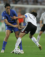 Italian forward (9) Toni Luca collides with German captain (13) Michael Ballack.  Italy defeated Germany, 2-0, in overtime in their FIFA World Cup semifinal match at FIFA World Cup Stadium in Dortmund, Germany, July 4, 2006.