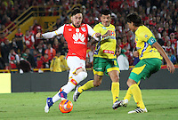 BOGOTA -COLOMBIA, 18-02-2017.Jonathan Gomez (L)  player of Independiente Santa Fe fights the ball against of Anibal Hernandez(R) player of Atletico Huila  during match for the date 4 of the Aguila League I 2017 played at Nemesio Camacho El Campin stadium . Photo:VizzorImage / Felipe Caicedo  / Staff
