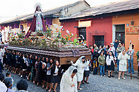 Antigua, Guatemala.  Semana Santa (Holy Week).  Women Carry an Anda (Float) with the Virgin Mary in a Religious Procession.