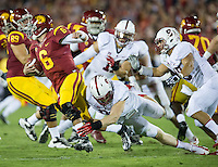 LOS ANGELES, CA - November 16, 2013:  Stanford Cardinal linebacker Trent Murphy (93) sacks the USC quarterback during the Stanford Cardinal vs the USC Trojans at Los Angeles Memorial Coliseum in Los Angeles, CA. Final score Stanford Cardinal 17, USC Trojans  20.