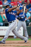 "Texas Rangers shortstop Elvis Andrus #1 swings during the MLB exhibition baseball game against the ""AAA"" Round Rock Express on April 2, 2012 at the Dell Diamond in Round Rock, Texas. The Rangers out-slugged the Express 10-8. (Andrew Woolley / Four Seam Images)."