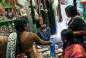 Women pilgrims negotiate price with a street vendor at the ancient city of Varanasi in Uttar Pradesh, India. Photograph: Sanjit Das/Panos