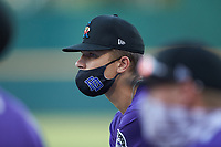 Slate Alford (16) of Bob Jones HS in Madison, AL playing for the Colorado Rockies scout team listens to his coach during the East Coast Pro Showcase at the Hoover Met Complex on August 2, 2020 in Hoover, AL. (Brian Westerholt/Four Seam Images)