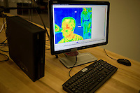A visitor is seen in a display as seen by a heat-sensing infrared camera in the Fab Lab at the Media Lab during MIT's Under the Dome open house in Cambridge, Massachusetts, USA.