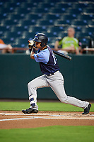 Trenton Thunder shortstop Gosuke Katoh (19) follows through on a swing during the second game of a doubleheader against the Bowie Baysox on June 13, 2018 at Prince George's Stadium in Bowie, Maryland.  Bowie defeated Trenton 10-1.  (Mike Janes/Four Seam Images)
