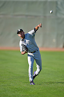Grand Junction Rockies starting pitcher Luis Guzman (19) warms up in the outfield before the game against the Ogden Raptors in Pioneer League action at Lindquist Field on August 24, 2016 in Ogden, Utah. The Raptors defeated the Rockies 11-10. (Stephen Smith/Four Seam Images)