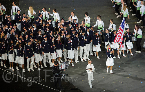 27 JUL 2012 - LONDON, GBR - Fencing competitor Mariel Zagunis (USA) leads the team from the USA around the Olympic Stadium during the Opening Ceremony of the London 2012 Olympic Games in Stratford, London, Great Britain (PHOTO (C) 2012 NIGEL FARROW)