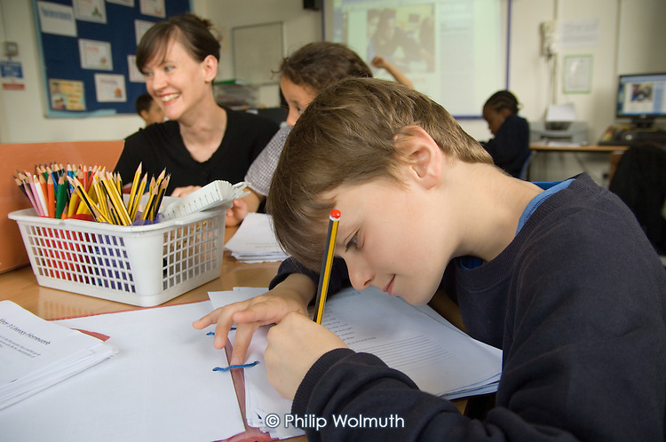 Teacher Rachel Poulton runs an after-school homework club for Year 3 and 4 pupils at St.Peter's C of E Primary School, Paddington.
