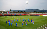 Spartak Trnava v St Johnstone...06.08.14  Europa League Qualifier 3rd Round<br /> Callum Davidson leads the saints players on a warm-up run in the FC Vion Stadium<br /> Picture by Graeme Hart.<br /> Copyright Perthshire Picture Agency<br /> Tel: 01738 623350  Mobile: 07990 594431