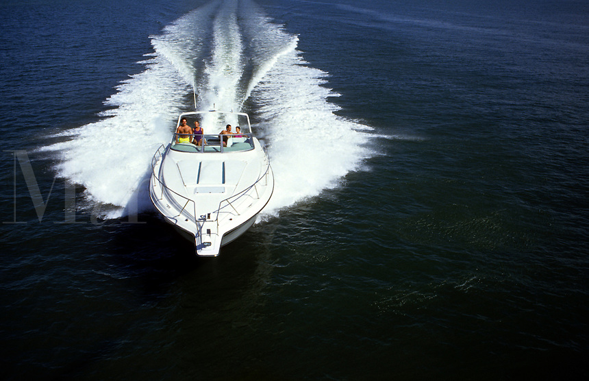 Couples running a speed boat.