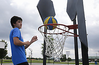 A.P. Anderson, 13, of Springdale plays bankshot basketball, Sunday, August 1, 2021 at the bank shot basketball court at Ward Nail Park in Lowell. Check out nwaonline.com/210802Daily/ for today's photo gallery. <br /> (NWA Democrat-Gazette/Charlie Kaijo)