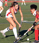 CHESHIRE CT. - 09 November 2020-110920SV05-#18 Raegan Bailey of Cheshire High tries to get the ball past #13 Aryana Wilson of Branford High during the semifinals of SCC field hockey tournament in Cheshire Monday..<br /> Steven Valenti Republican-American
