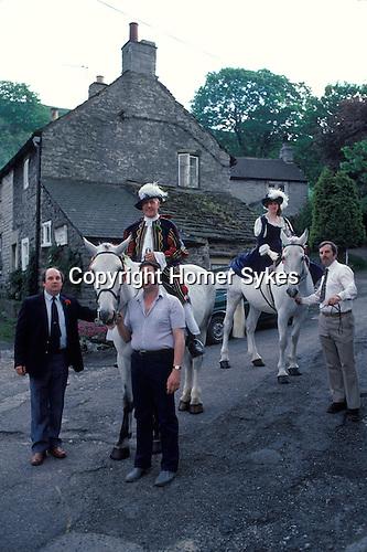 Castleton Garland day, Castleton Derbyshire UK May 31st. Oak Apple Day King and Queen. 1980s.