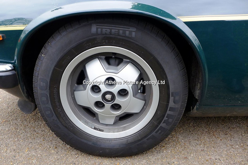 """Pictured: One of the alloy wheels of the Jaguar up for auction, once owned by Eamonn Holmes<br /> Re: A luxury open-top car sold by TV's Eamonn Holmes to pay off his """"massive"""" tax bill is up for grabs at auction.<br /> The host of Good Morning Britain bought the 5.3 litre Jaguar when he was earning big bucks with the BBC.<br /> But Eamonn was made redundant and at the same time he was hit with an £11,000 demand from the Inland Revenue.<br /> The car was costing him a fortune to run - it did under 15mpg.<br /> After paying a whopping £36,000 for the Jaguar XJSC, Eamonn flogged it for just £8,000 a year later.<br /> The car has an identical price tag at auction almost 30 years later.    <br /> Eamonn, 57, told how he got shot of the Jag when the 1990 Gulf War sparked a big hike in fuel prices.<br /> He said: """"Cars are my weakness - in 1989 I bought a British Racing Green Jaguar.<br /> """"I paid £36,000 in March 1989 then in early 1990 the Gulf War broke out."""