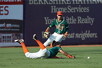 Greensboro Grasshoppers left fielder Ricardo Cespedes (7) can't make a diving catch as center fielder Connor Scott (23) backs up the play during the game against the West Virginia Power at First National Bank Field on August 9, 2018 in Greensboro, North Carolina. The Power defeated the Grasshoppers 5-3 in game one of a double-header. (Brian Westerholt/Four Seam Images)