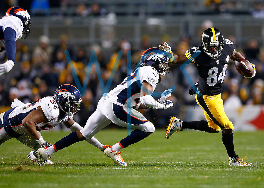Antonio Brown #84 of the Pittsburgh Steelers stiff arms Bradley Roby #29 of the Denver Broncos after catching a pass in the second quarter during the game at Heinz Field on December 20, 2015 in Pittsburgh, Pennsylvania. (Photo by Jared Wickerham/DKPittsburghSports)