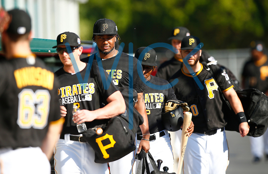 Josh Bell #55 of the Pittsburgh Pirates walks to the fields before his workout during spring training at Pirate City in Bradenton, Florida on February 20, 2016. (Photo by Jared Wickerham / DKPS)
