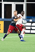 FOXBOROUGH, MA - JUNE 26: Pierre Cacet #44 of the New England Revolution battles Caiser Gomes #4 of North Texas SC for the ball during a game between North Texas SC and New England Revolution II at Gillette Stadium on June 26, 2021 in Foxborough, Massachusetts.