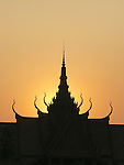 The sun sets behind the National Museum in Phnom Penh, built in 1918.