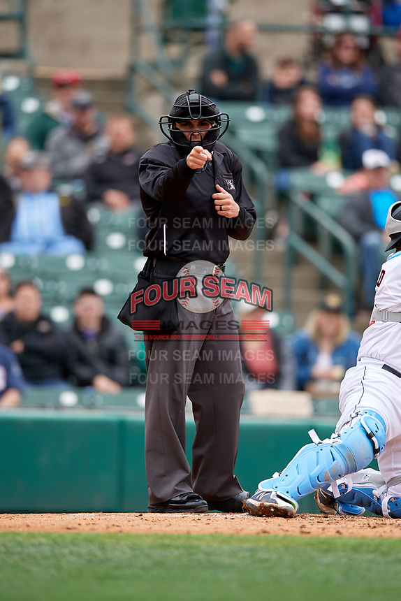 Umpire Mike Wiseman calls a strike during an International League game between the Charlotte Knights and Rochester Red Wings on June 16, 2019 at Frontier Field in Rochester, New York.  Rochester defeated Charlotte 3-2 in the second game of a doubleheader.  (Mike Janes/Four Seam Images)