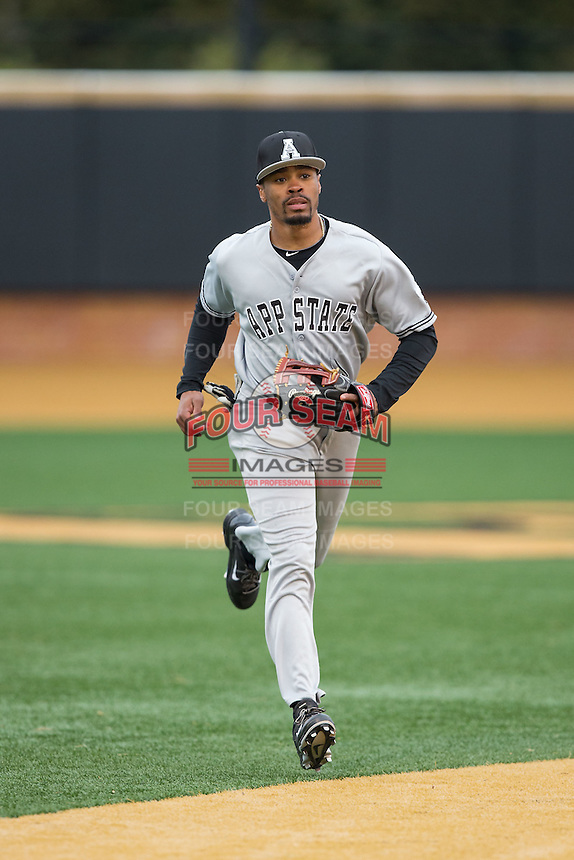 Appalachian State Mountaineers center fielder Jaylin Davis (21) jogs off the field between innings of the game against the Wake Forest Demon Deacons at Wake Forest Baseball Park on February 13, 2015 in Winston-Salem, North Carolina.  The Mountaineers defeated the Demon Deacons 10-1.  (Brian Westerholt/Four Seam Images)