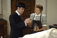 Detective William Murdoch (Yannick Bisson) and Dr. Julia Ogden (Hélène Joy) review a new forensic instrument in Shaftesbury Films' The Murdoch Mysteries. (CNW Group/Shaftesbury Films Inc.)