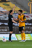 Wolverhampton Wanderers' Ruben Neves (right) is shown a yellow card by Darren England for persistent fouling<br /> <br /> Photographer David Horton/CameraSport<br /> <br /> The Premier League - Wolverhampton Wanderers v Fulham - Sunday 4th October 2020 - Molineux Stadium - Wolverhampton<br /> <br /> World Copyright © 2020 CameraSport. All rights reserved. 43 Linden Ave. Countesthorpe. Leicester. England. LE8 5PG - Tel: +44 (0) 116 277 4147 - admin@camerasport.com - www.camerasport.com