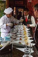 Peru, Machu Picchu.  Staff Preparing Lunch on the Inca Rail Executive Class Train from Ollantaytambo to Machu Picchu.