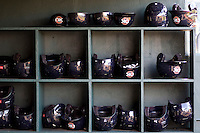 Oklahoma City RedHawks helmet rack before the game on July 9, 2013 at the Dell Diamond in Round Rock, Texas. (Andrew Woolley/Four Seam Images)