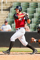 Kevan Smith #32 of the Kannapolis Intimidators follows through on his swing against the Hickory Crawdads at CMC-Northeast Stadium on April 8, 2012 in Kannapolis, North Carolina.  The Intimidators defeated the Crawdads 12-11.  (Brian Westerholt/Four Seam Images)